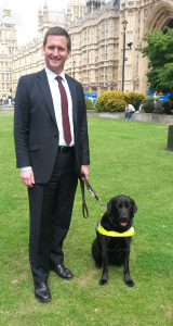 Lottie and Lord Holmes outside the Houses of Parliament. June, 2014